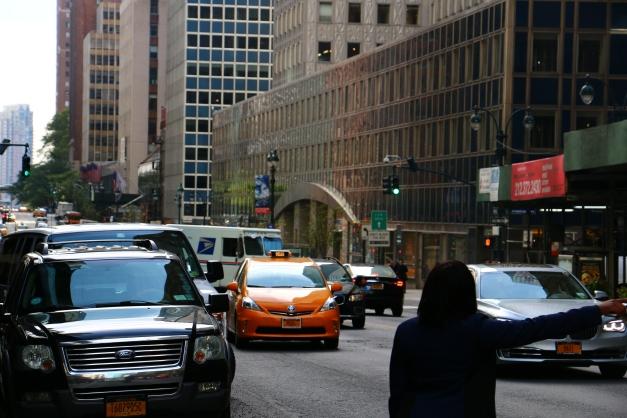 Woman Hails A Cab