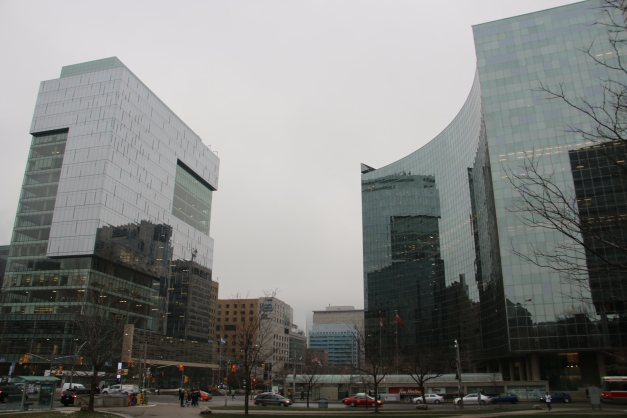 In front of Curved Glass Building